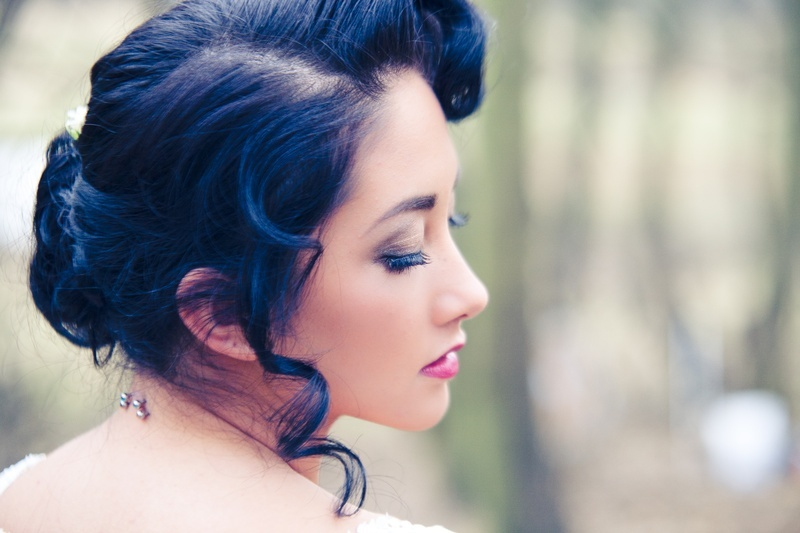 Vintage-bride-with-dark-hair-parted-bridal-updo.full