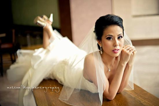 photo of stunning classic bride wedding updo dramatic eyes