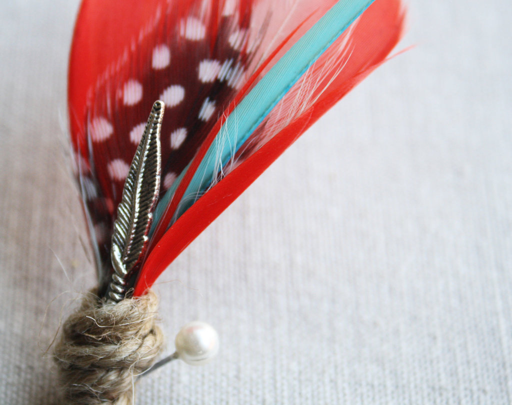 grooms boutonniere feathers red aqua black white