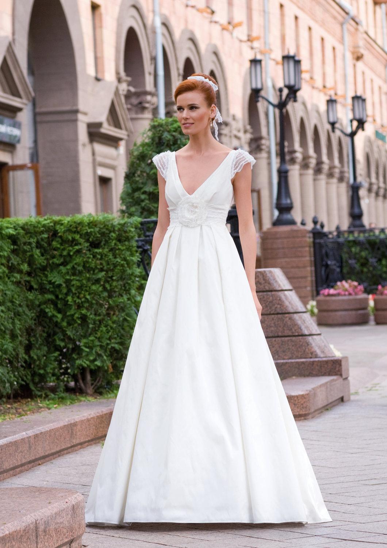 deep v wedding dress with sheer cap sleeves