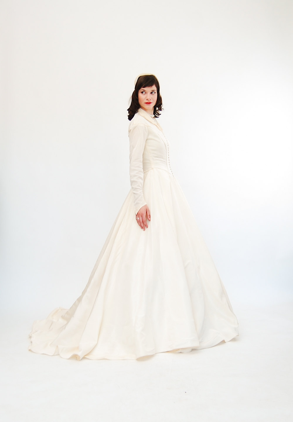 Taffeta-wedding-dress-for-vintage-brides-sleeves-covered-buttons.full