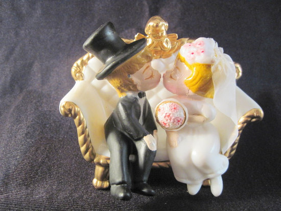 cute wedding cake topper antique bride and groom kissing