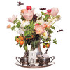 Unique-wedding-centerpiece-ranunculus-peonies-cosmos-tulips-mint-geraniums-garden-roses-tuberose-citrus-berries-freshwater-pearls-feathers.square
