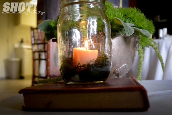 vintage wedding shoot with mason jar centerpieces votives moss