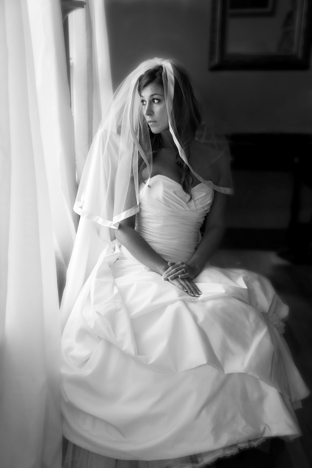 Classic-bride-wears-white-wedding-dress-tiered-bridal-veil.full