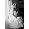 Classic-bride-wears-white-wedding-dress-tiered-bridal-veil.square