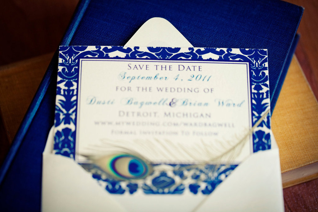 Elegant-navy-ivory-wedding-save-the-date-with-peacock-feather.full