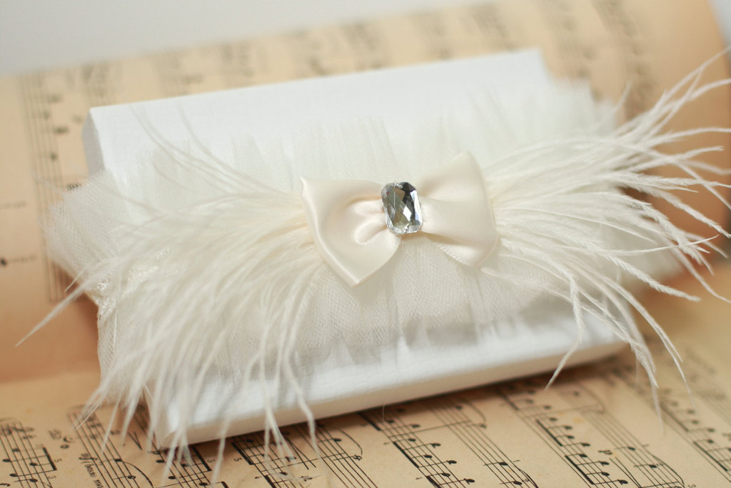 feather adorned bridal clutch with bow