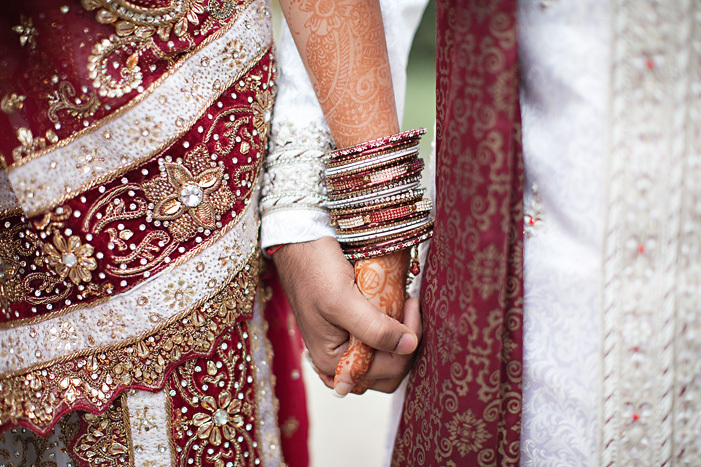 Cultural-real-wedding-indian-weddings-chicago-il-gold-red-mahogony-bride-groom-hold-hands.full