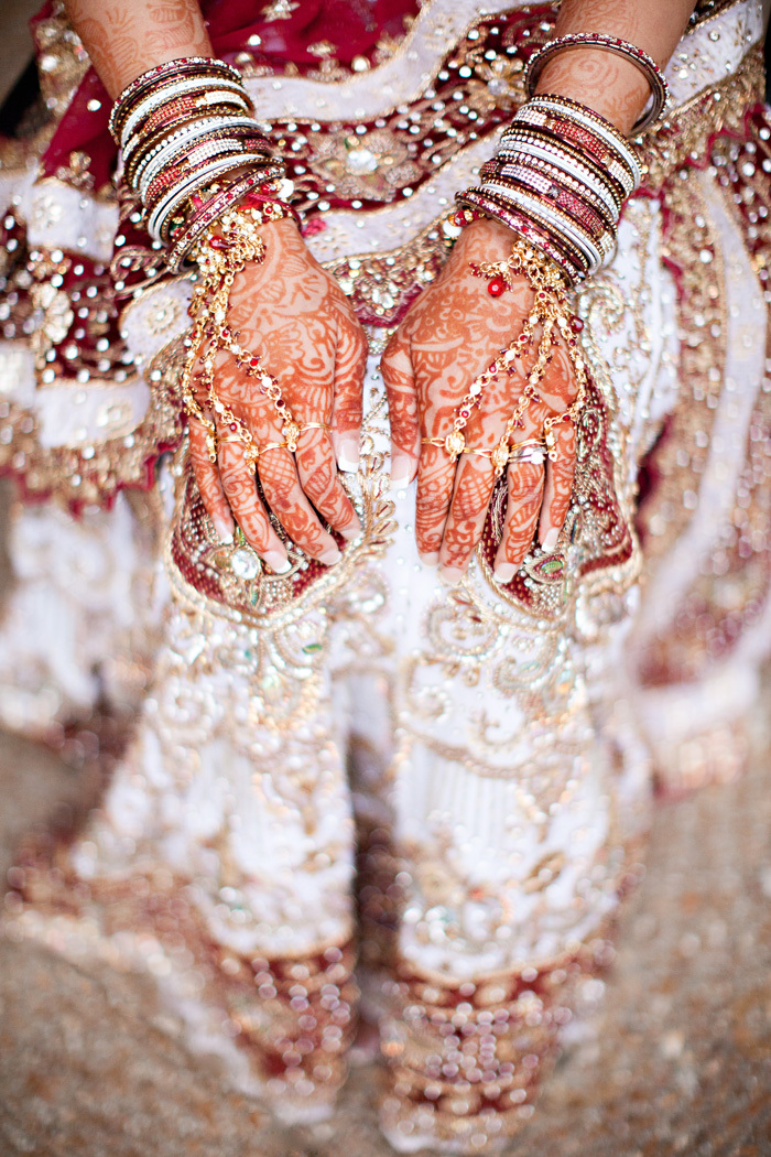 Cultural-real-wedding-indian-weddings-chicago-il-gold-red-mahogony-bride-wears-henna-layers-of-bangles.full