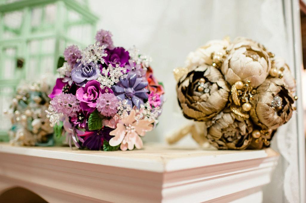 Purple-brooch-bouquet-gold-wedding-flowers-fabric.full