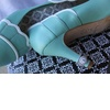 Turquoise-wedding-shoes-with-diamond-engagement-ring.square
