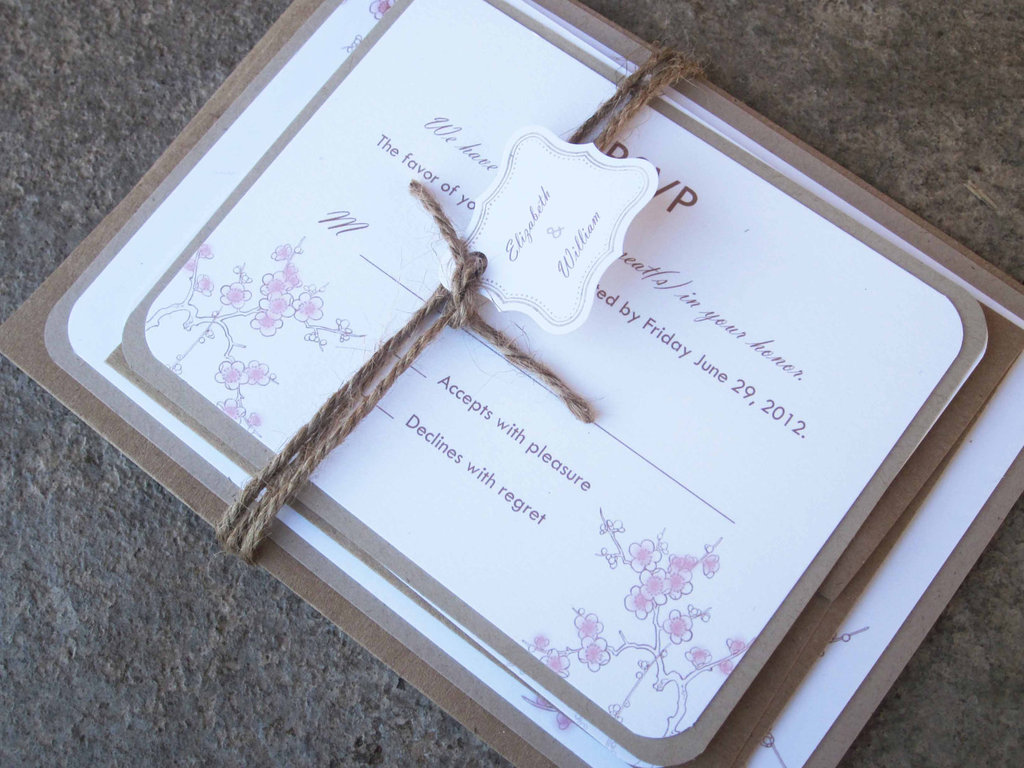 blossom wedding invitation tied with burlap
