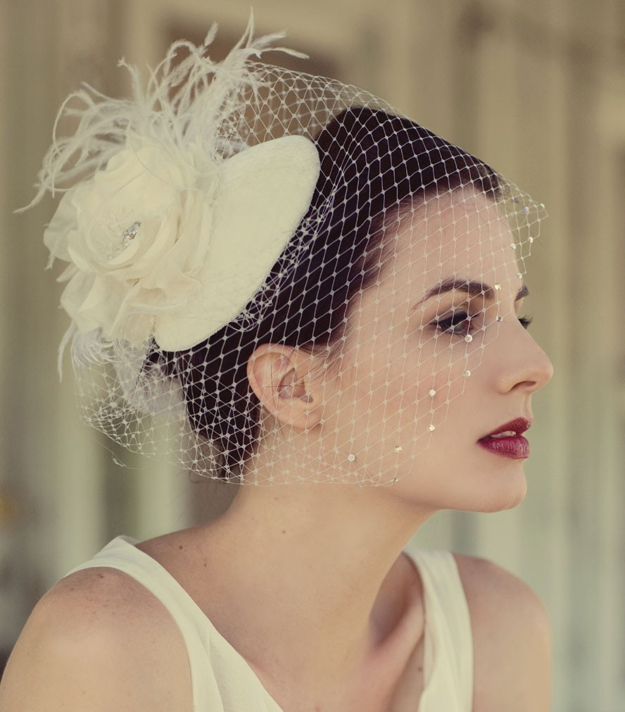 Wedding-hats-with-birdcage-veil-feather-floral-accents.full