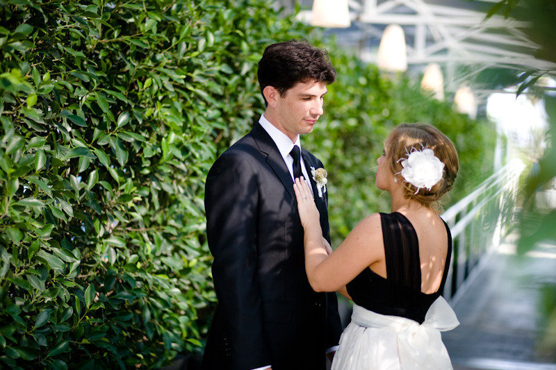 bride and groom wear black and white outdoor wedding photo
