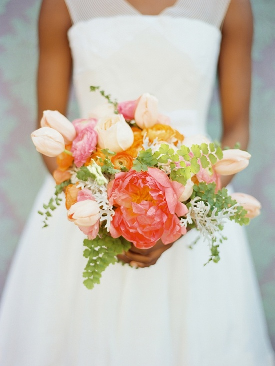photo of stunning wedding flowers peach coral pink green bridal bouquet