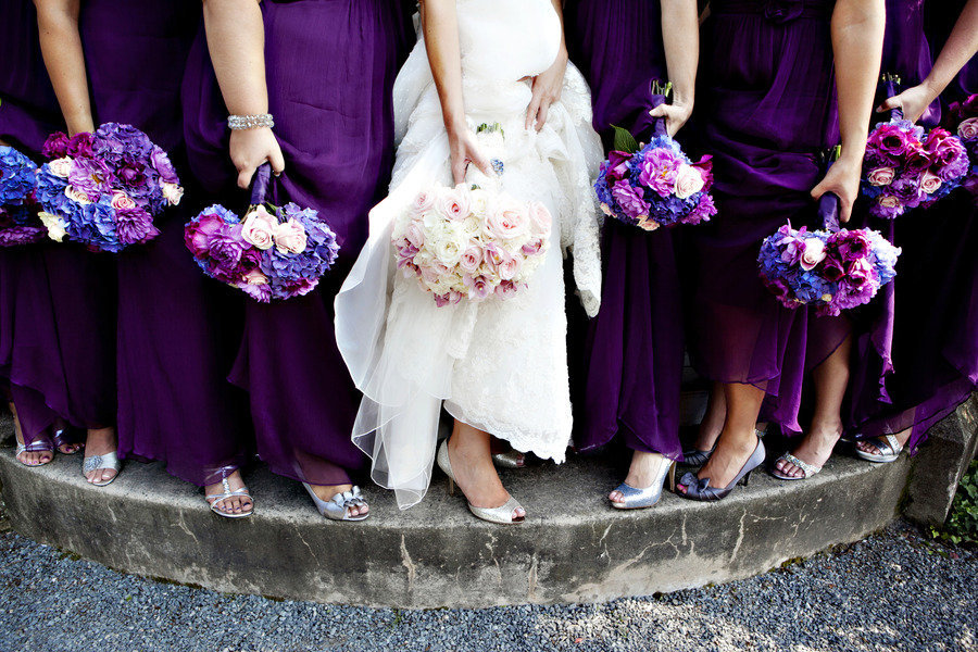 Bride-with-bridesmaids-show-off-purple-blue-wedding-flowers.full