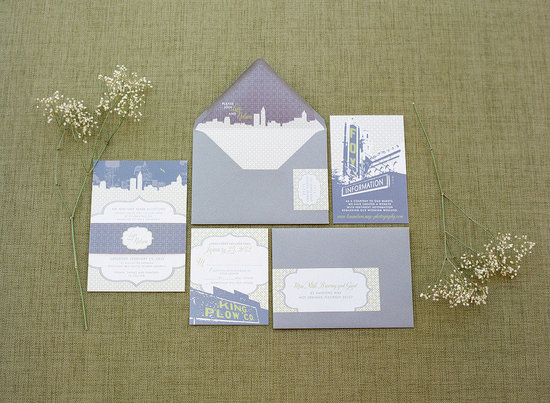 Romantic wedding invitations in green and gray with city landscape.