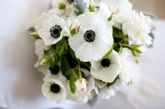 Black accents on white and green wedding flowers anemones.
