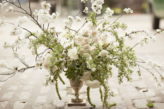Green  and cream wedding reception centerpiece brancy details