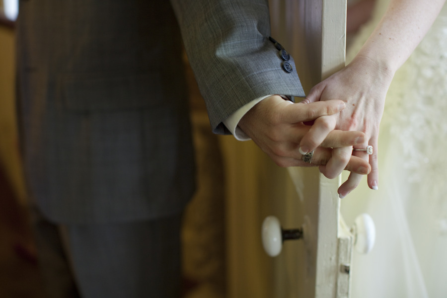 First-look-artistic-wedding-photo-bride-groom-hold-hands.full