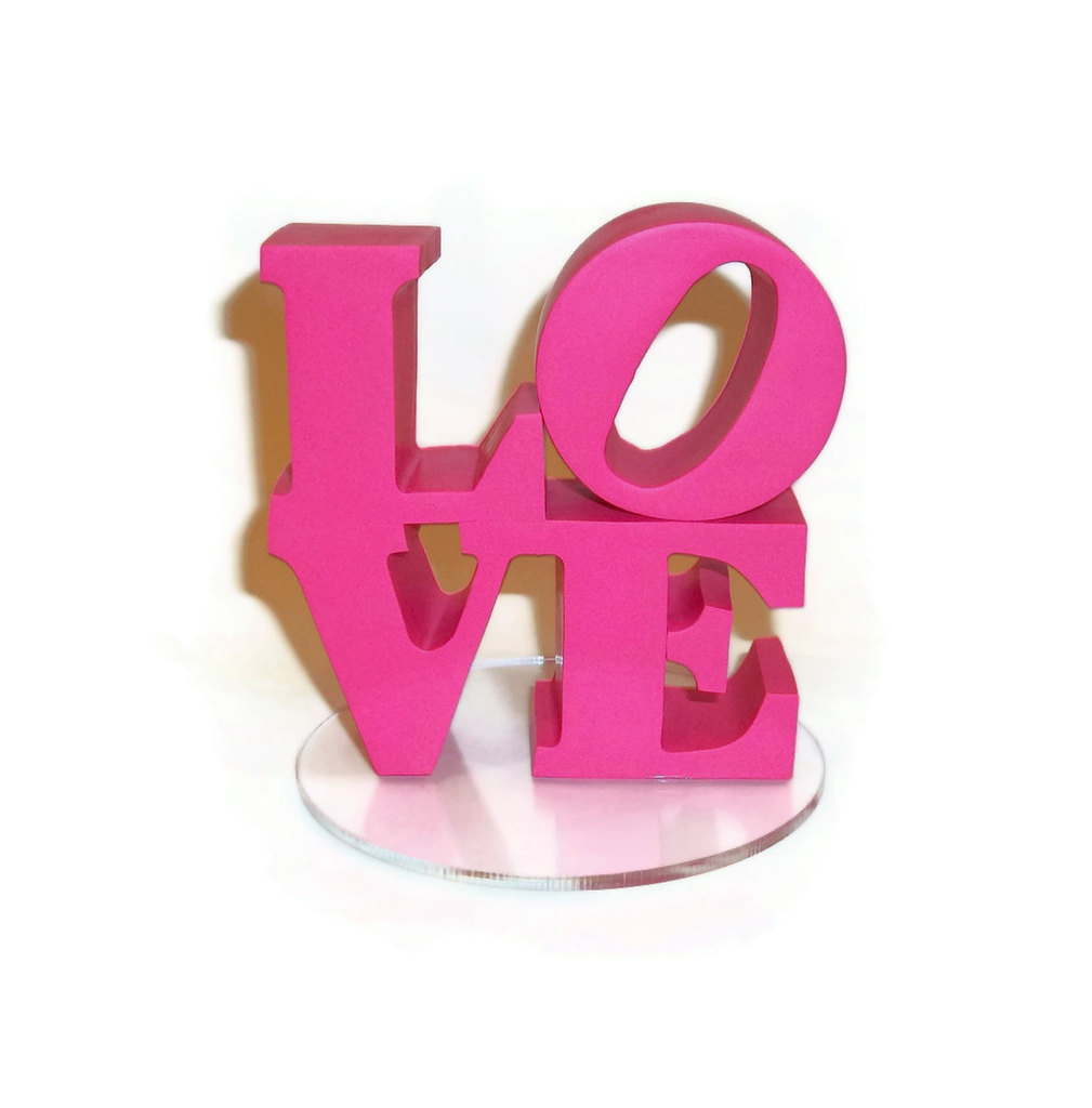 photo of Hot pink LOVE wedding cake topper