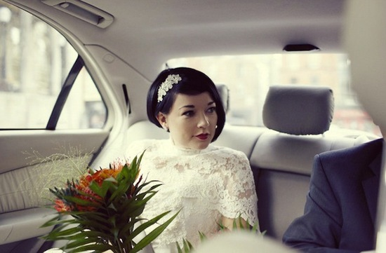 short wedding hair bride wears lace wedding cape