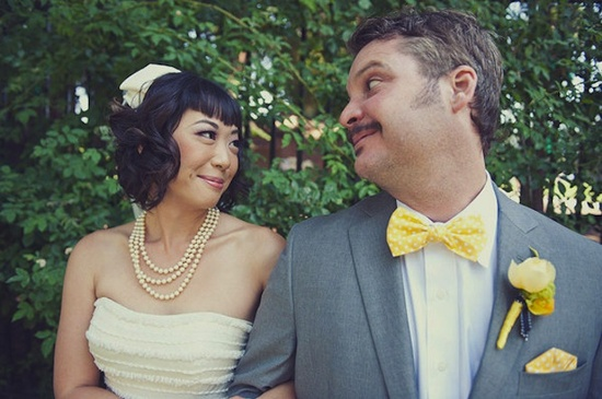 short wedding hairstyle with bangs birdcage veil