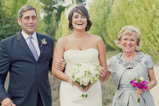 short wedding hair bride walks ceremony aisle with parents