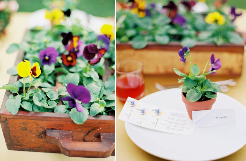 wedding centerpiece idea purple yellow flowers in vintage suitcase