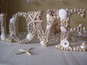 photo of Seashell love wedding sign