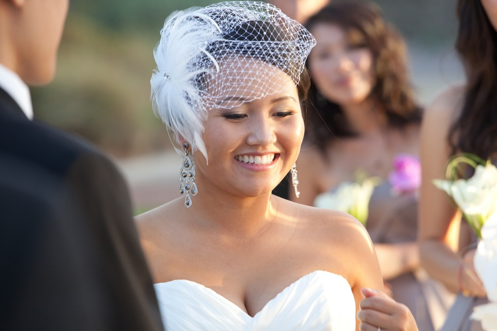Beautiful-asian-bride-wears-sweetheart-wedding-dress-birdcage-veil.full