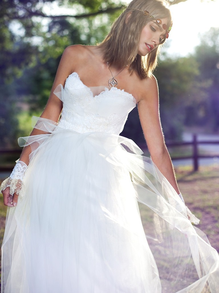 photo of Queen for a Day wedding dress by Claire LaFaye