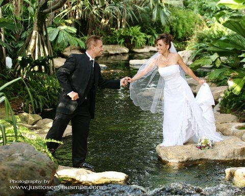 Bride and Groom on Rocks in Water