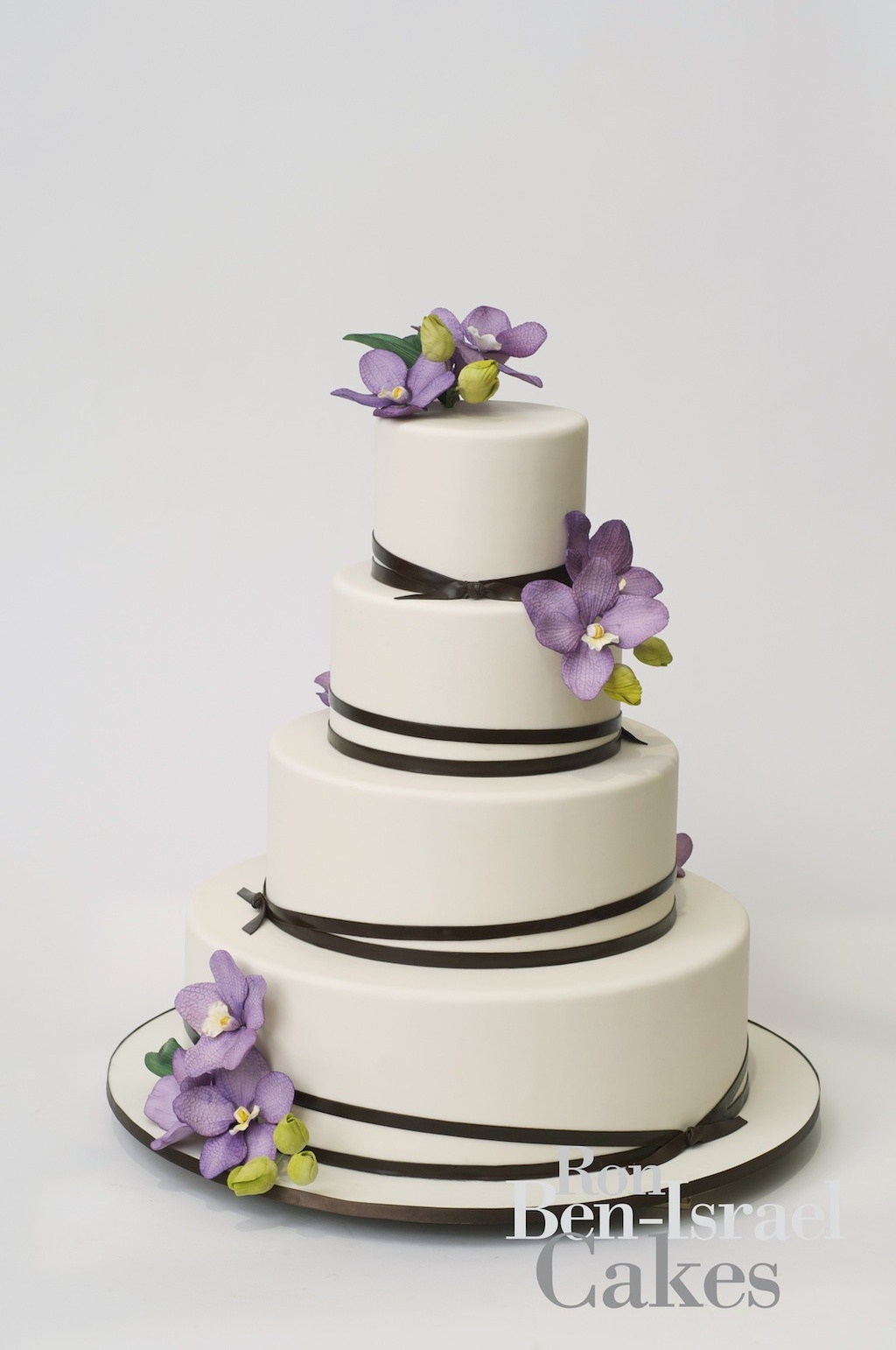 wedding-cake-inspiration-Ron-Ben-Isreal-wedding-cakes-white-with-chocolate-brown-ribbon-lavendar-orchids
