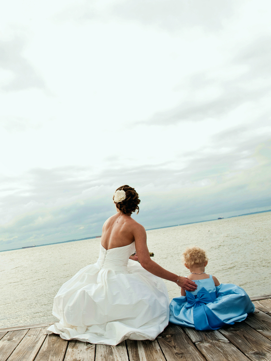 bride with kid on dock edited