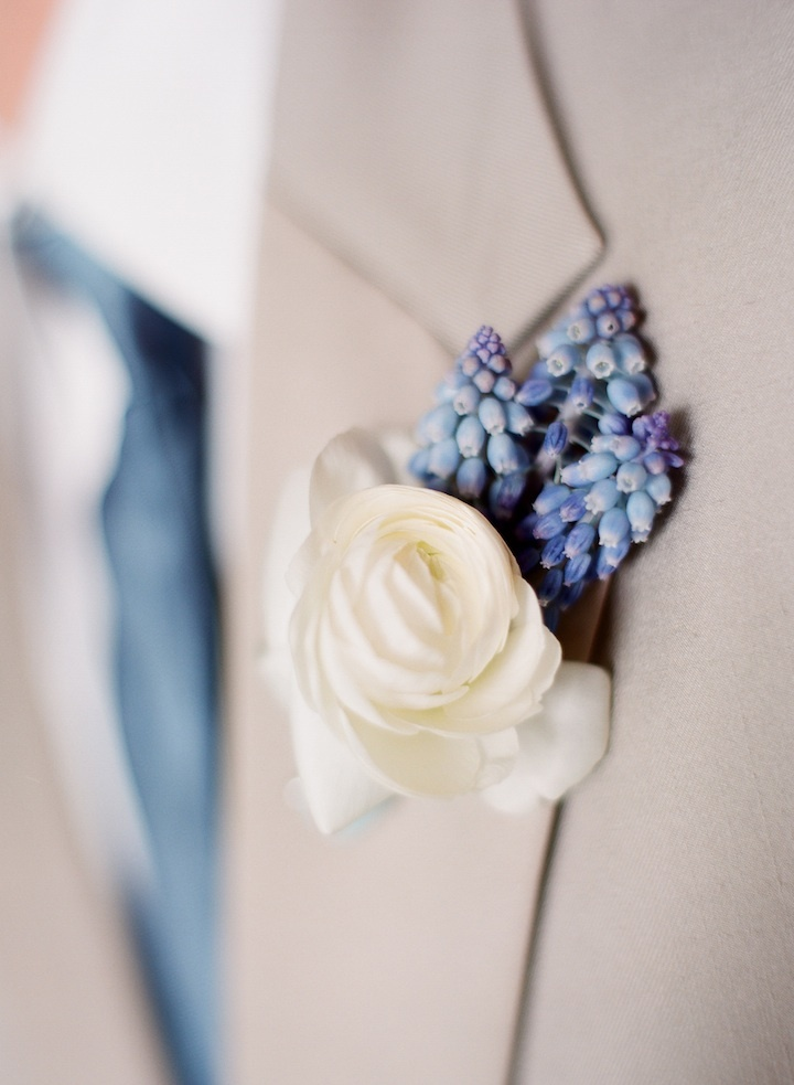 Handsome ivory and blue boutonniere