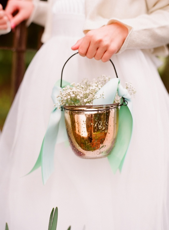 Copper flower girl baskets with baby's breath