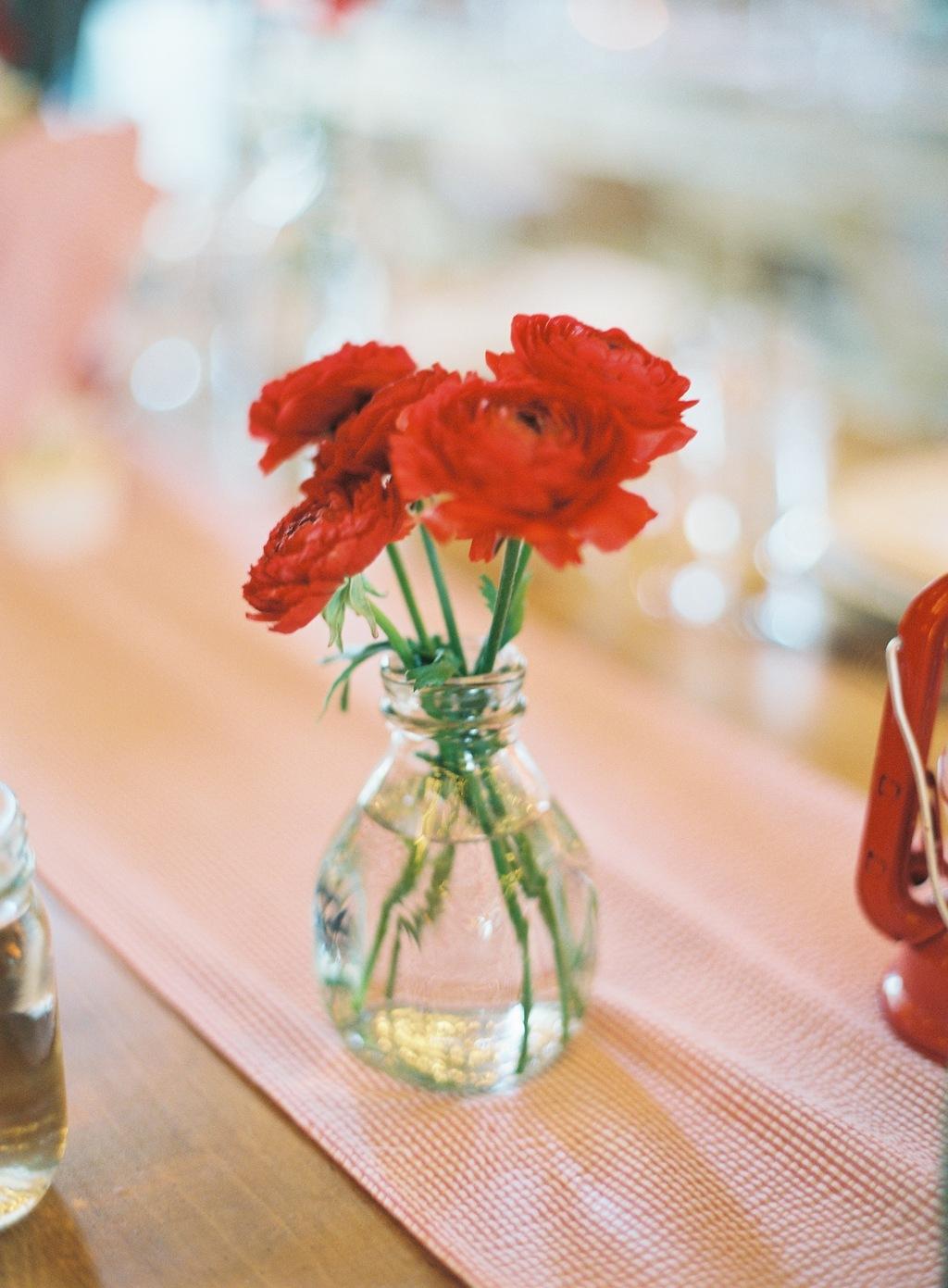 Wedding-barn-santa-barbara-chic-state-fair-jose-villa-table-setting-antique-bottles-retro-red-flowers-8.full