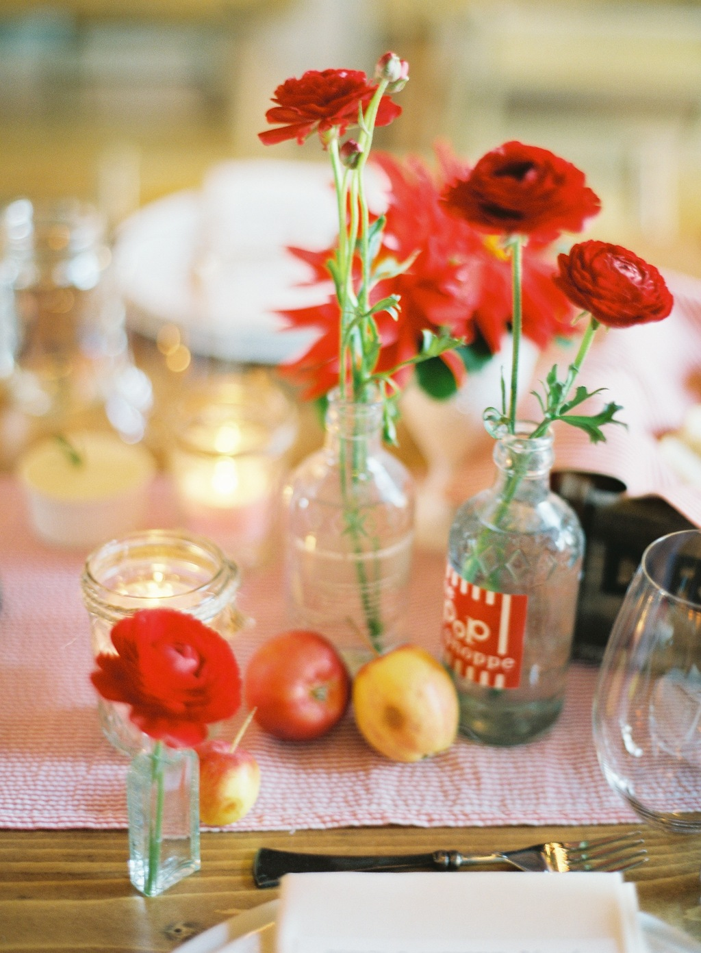 Wedding-barn-santa-barbara-chic-state-fair-jose-villa-table-setting-antique-bottles-retro-red-flowers-08.full