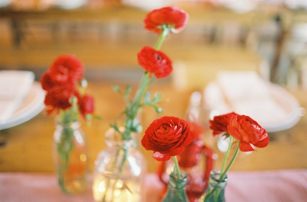 Wedding-barn-santa-barbara-chic-state-fair-jose-villa-table-setting-antique-bottles-retro-red-flowers-11a.full