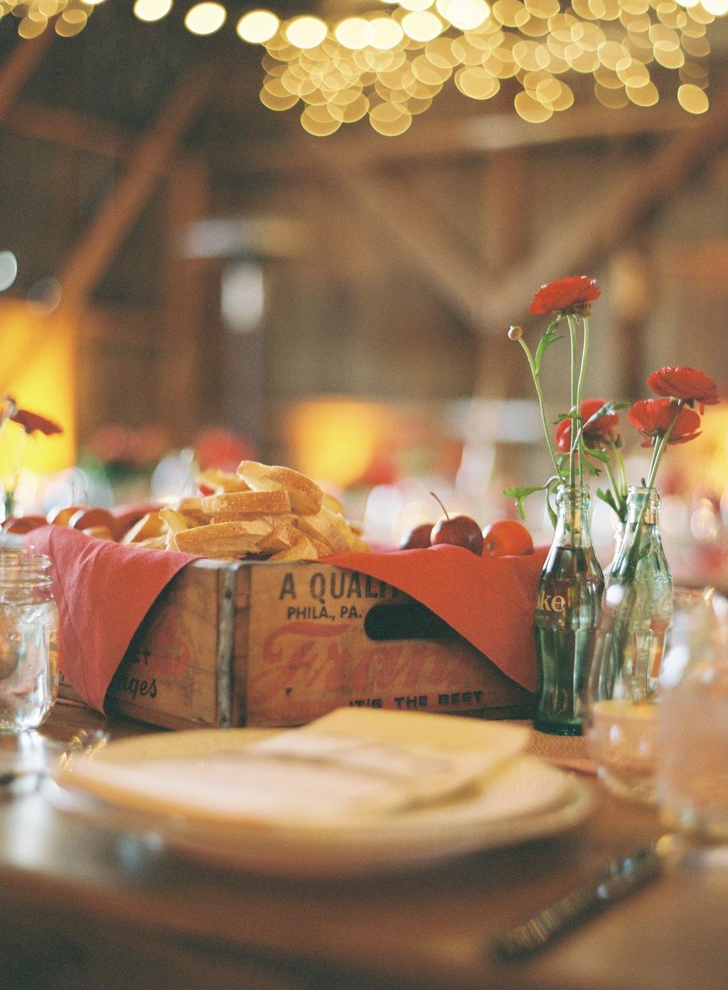Wedding-barn-santa-barbara-chic-state-fair-jose-villa-table-setting-antique-bottles-retro-red-flowers-25.full