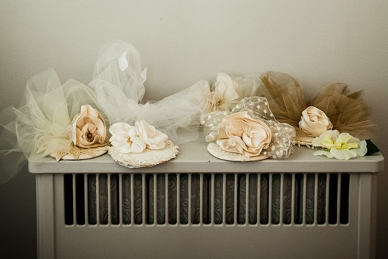 photo of romantic mansion wedding with vintage inspired bride and groom fascinators veils