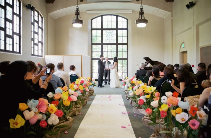 Rose-petal-aisle-runner-for-outdoor-wedding-ceremonies-colorful-arrangements-lining-aisle-2.full