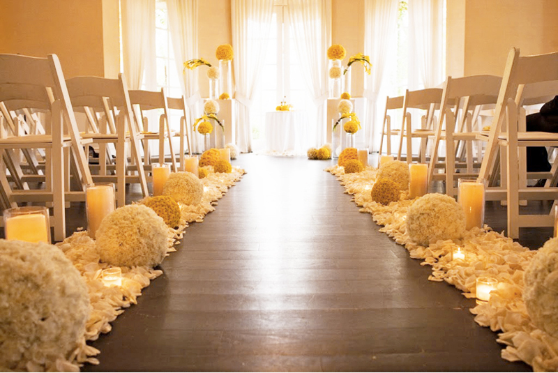 Elegant-wedding-ceremony-aisle-wood-with-white-yellow-wedding-flowers.full