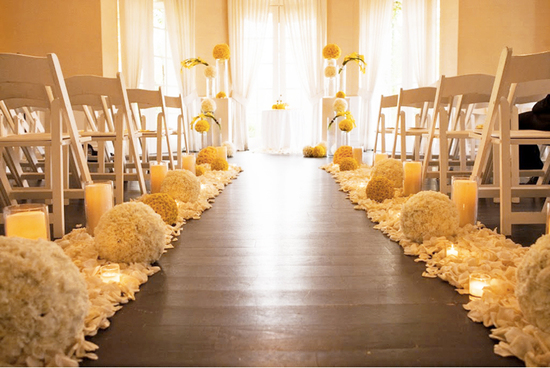 elegant wedding ceremony aisle wood with white yellow wedding flowers