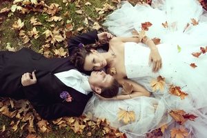 photo of hot wedding planning topics bride groom in bed of leavea