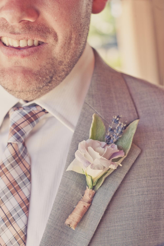 Elegant-real-weddings-lavender-peach-wedding-colors-grooms-boutonniere.full