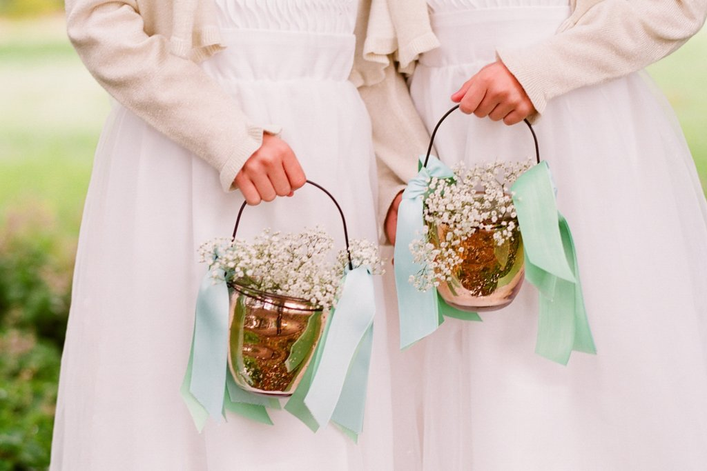 romantic outdoor wedding with Anthropologie inspired flower girl baskets