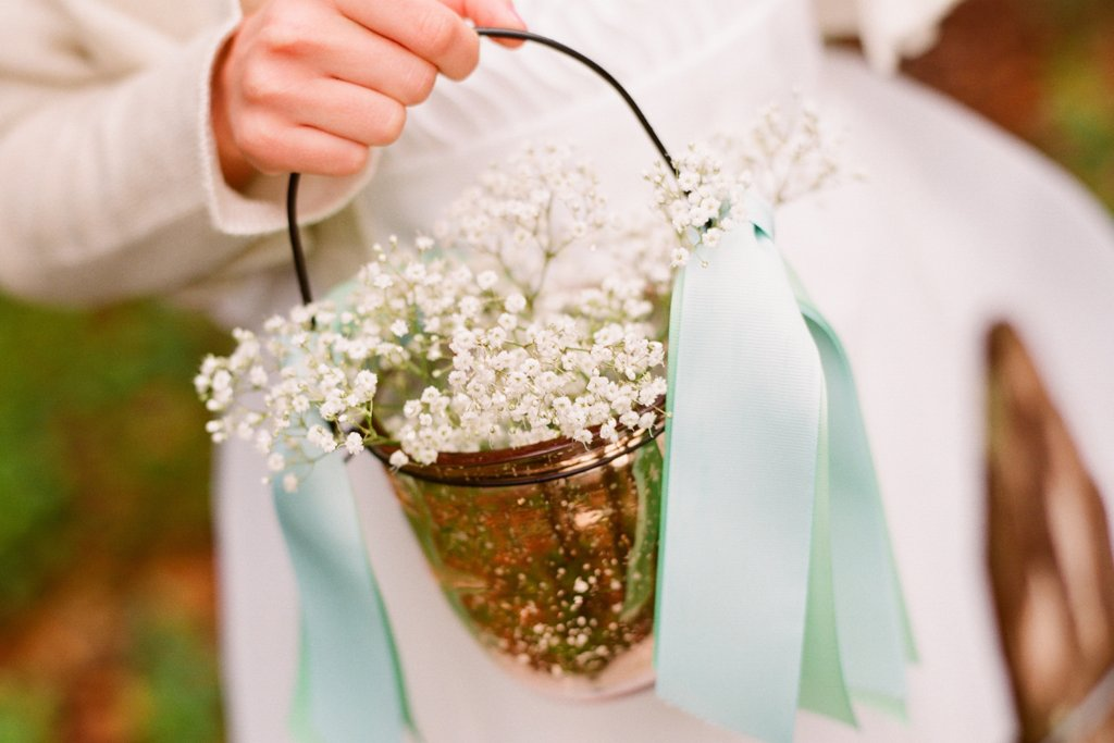 romantic outdoor wedding with Anthropologie inspired flower girl basket